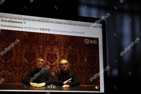 "Founders of Dolce&Gabbana Domenico Dolce, left, and Stefano Gabbana apologize in a video on Chinese social media, saying ""sorry"" in Mandarin seen on a computer screen in Beijing, China, . The Italian fashion house has been in hot water for controversial video ads and insulting remarks on China made by Instagram accounts of its co-founder"