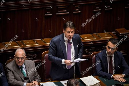 Italian Prime Minister Giuseppe Conte (C) gives a statement on Italian budget to the Chamber of Deputies next to Minister for European Affairs Paolo Savona (L) and Deputy Prime Minister Luigi Di Maio (R)