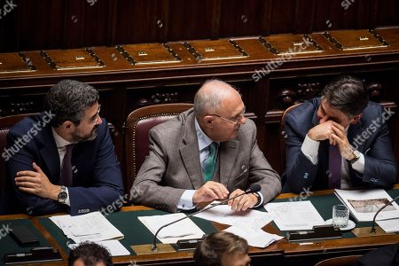Italian Prime Minister Giuseppe Conte (R) gives a statement on Italian budget to the Chamber of Deputies next to Minister for Relations with Parliament, Riccardo Fraccaro (L) and Minister for European Affairs, Paolo Savona (C)