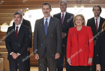 King Felipe VI of Spain (C), European Commissioner for Regional Policy, Corina Cretu (R), Canarias regional President, Fernando Clavijo (L), and presidents of EU outermost regions pose for a group photo at the Alfredo Kraus Auditorium in Las Palmas, Canary Islands, Spain, 23 November 2018, during the 23rd Conference of the Outermost Regions of the EU.