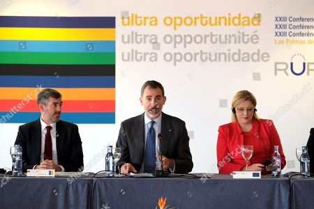 King Felipe VI of Spain (C), European Commissioner for Regional Policy, Corina Cretu (R), and Canarias regional President, Fernando Clavijo (L), attend the 23rd Conference of the Outermost Regions of the EU at the Alfredo Kraus Auditorium in Las Palmas, Canary Islands, Spain, 23 November 2018.