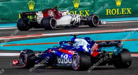 Monaco's Formula One driver Charles Leclerc (top) of Sauber F1 Team and New Zealand's Formula One driver Brendon Hartley (bottom) of Scuderia Toro Rosso in action during the second practice session at Yas Marina Circuit in Abu Dhabi, United Arab Emirates, 23 November 2018. The Formula One Grand Prix of Abu Dhabi will take place on 25 November 2018.