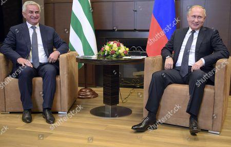 "Russian President Vladimir Putin (right) and President of Abkhazia Raul Khajimba (left) during a meeting at the ""Bocharov Ruchei"" residence."