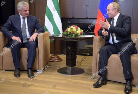 """Stock Picture of Russian President Vladimir Putin (right) and President of Abkhazia Raul Khajimba (left) during a meeting at the """"Bocharov Ruchei"""" residence."""