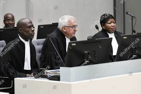 ICC's prosecutor Fatou Bensouda (R) and deputy prosecutor James Stewart (C) are seen during the appearance of war crimes suspect Alfred Yekatom (unseen), who is charged for alleged murder, deportation and torture of Muslims in the Central African Republic (CAR), at the International Criminal Court (ICC), in The Hague, Netherlands, 23 November 2018. Others are not identified.