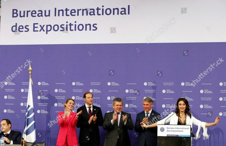 Russian delegation with Russian singer Aida Garifullina, right, and Russian Minister of Industry and Trade Denis Manturov, second left attend the 164th General Assembly of the Bureau International des Expositions (BIE) in Paris, . Cities in Russia, Japan and Azerbaijan are about to find out whether they can host the 2025 World Expo, an event expected to draw millions of visitors and showcase the local economy and culture. The 170 member states of the Paris-based Bureau International des Expositions are voting Friday on whether to hand the expo to Yekaterinburg, Osaka or Baku