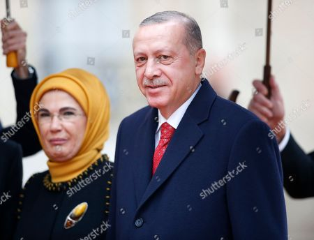 Turkish President Recep Tayyip Erdogan with his wife Emine Gulbaran (background) at the Elysee palace for the official lunch after the international ceremony for the Centenary of the WWI Armistice of 11 November 1918