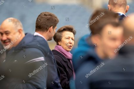 Stock Photo of HRH The Princess Royal, chats with Alastair Kellock, Scottish Rugby Ambassador and Dominic McKay, Chief Operating Officer of Scottish Rugby during the team run, training session for Scotland at BT Murrayfield, Edinburgh