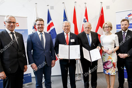 Stock Image of From left to right; Secretary-General of the European Free Trade Association (EFTA) Swiss Henri Getaz, Iceland's Minister for Foreign Affairs Gulaugur Thor Thordarson, Indonesia's Trade Minister Enggartiasto Lukita, Swiss Minister of Economic Johann Schneider-Ammann, Liechtenstein's Minister of Foreign Affairs Aurelia Frick and Norway's Minister of Trade and Industry Torbjorn Roe Isaksen, pose for an official photo after signing an agreement between EFTA and Indonesia, during an EFTA Ministerial meeting at the headquarters of the European Free Trade Association, EFTA, in Geneva, Switzerland, Friday, November 23, 2018.