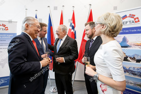 From left to right; Indonesia's Trade Minister Enggartiasto Lukita, Iceland's Minister for Foreign Affairs Gulaugur Thor Thordarson, Swiss Minister of Economic Johann Schneider-Ammann, Norway's Minister of Trade and Industry Torbjorn Roe Isaksen and Liechtenstein's Minister of Foreign Affairs Aurelia Frick cheer with sparkling wine, after signing an agreement between EFTA and Indonesia, during an EFTA Ministerial meeting at the headquarters of the European Free Trade Association, EFTA, in Geneva, Switzerland, Friday, November 23, 2018.