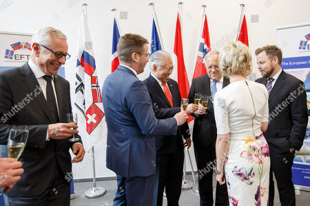 Stock Image of From left to right; Secretary-General of the European Free Trade Association (EFTA) Swiss Henri Getaz, Iceland's Minister for Foreign Affairs Gulaugur Thor Thordarson, Indonesia's Trade Minister Enggartiasto Lukita, Swiss Minister of Economic Johann Schneider-Ammann, Liechtenstein's Minister of Foreign Affairs Aurelia Frick and Norway's Minister of Trade and Industry Torbjorn Roe Isaksen, cheer with sparkling wine, after signing an agreement between EFTA and Indonesia, during an EFTA Ministerial meeting at the headquarters of the European Free Trade Association, EFTA, in Geneva, Switzerland, Friday, November 23, 2018.
