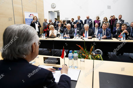 Stock Picture of Swiss Minister of Economic Johann Schneider-Ammann, sitting next to Liechtenstein's Minister of Foreign Affairs Aurelia Frick, 2nd left, Secretary-General of the European Free Trade Association (EFTA) Swiss Henri Getaz, 2nd left, Iceland's Minister for Foreign Affairs Gulaugur Thor Thordarson, 2n right, and Norway's Minister of Trade and Industry Torbjorn Roe Isaksen, right, delivers his speech in front of Indonesia's Trade Minister Enggartiasto Lukita, left, during the signing ceremony of an agreement between EFTA and Indonesia, at the EFTA Ministerial meeting at the headquarters of the European Free Trade Association, EFTA, in Geneva, Switzerland, Friday, November 23, 2018.