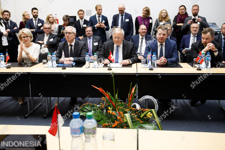 Swiss Minister of Economic Johann Schneider-Ammann, sitting next to Liechtenstein's Minister of Foreign Affairs Aurelia Frick, 2nd left, Secretary-General of the European Free Trade Association (EFTA) Swiss Henri Getaz, 2nd left, Iceland's Minister for Foreign Affairs Gulaugur Thor Thordarson, 2n right, and Norway's Minister of Trade and Industry Torbjorn Roe Isaksen, right, delivers his speech, during the signing ceremony of an agreement between EFTA and Indonesia, at the EFTA Ministerial meeting at the headquarters of the European Free Trade Association, EFTA, in Geneva, Switzerland, Friday, November 23, 2018.