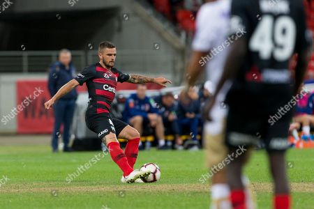 Western Sydney Wanderers defender Josh Risdon (4) passes the ball at the Hyundai A-League Round 5 soccer match between Western Sydney Wanderers FC and Newcastle Jets at Spotless Stadium in NSW