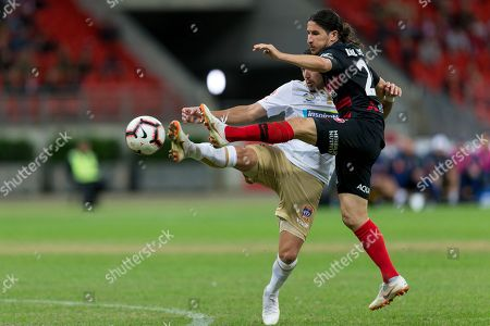 Newcastle Jets forward Dimitri Petratos (7) and Western Sydney Wanderers defender Raul Llorente (24) battle for the ball at the Hyundai A-League Round 5 soccer match between Western Sydney Wanderers FC and Newcastle Jets at Spotless Stadium in NSW