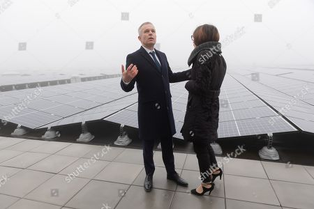 Stock Photo of Francois de Rugy and Celia Blauel on the photovoltaic roof