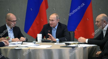 Left to right: First Deputy Head of the Presidential Administration of Russia Sergei Kiriyenko ; President of Russia Vladimir Putin ; and First Deputy Prime Minister of Russia - Russian Finance Minister Anton Siluanov during an expanded meeting of the State Council Presidium.