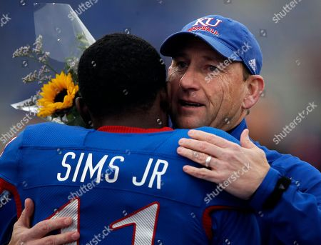 Stock Picture of David Beaty, Steven Sims Jr. Kansas head coach David Beaty, right, embraces senior Steven Sims Jr. (11) before an NCAA college football game against Texas in Lawrence, Kan