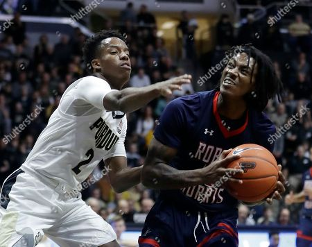Robert Morris's Koby Thomas, right, is defended by Purdue's Eric Hunter Jr., left, during the first half of an NCAA college basketball game, in West Lafayette, Ind