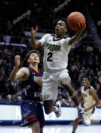 Purdue's Eric Hunter Jr. shoots against Robert Morris's Dante Treacy during the second half of an NCAA college basketball game, in West Lafayette, Ind. Purdue won 84-46