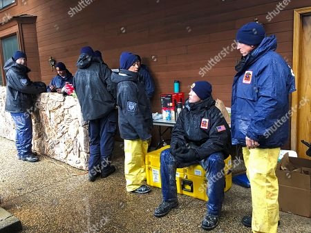 Imelda Cordova, Andrew Ricker, Craig Stevens. National Urban Search & Rescue Response System Orange County CATF-5 team members Imelda Cordova, third from right, talks Andrew Ricker, and Craig Stevens, far right, as their team take cover from the rain in Paradise, Calif., . High winds and heavy rains are temporarily halting the work of some search teams out looking for remains of people caught up in the deadly wildfire. The Camp Fire, which destroyed the historical mining town of Paradise, is the most deadly in state history, with 84 fatalities as of Friday, according to statistics from the California Department of Forestry and Fire Protection. It's also the deadliest in the U.S. in a century