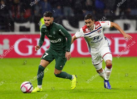 Saint-Etienne's Remy Cabella, left, duels for the ball with Lyon's Rafael da Silva during the French League One soccer match between Lyon and Saint-Etienne at the Stade de Lyon near Lyon, France
