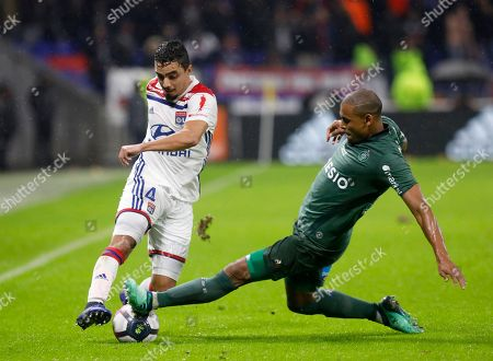Lyon's Rafael da Silva, left, duels for the ball with Saint-Etienne's Gabriel Silva during the French League One soccer match between Lyon and Saint-Etienne at the Stade de Lyon near Lyon, France
