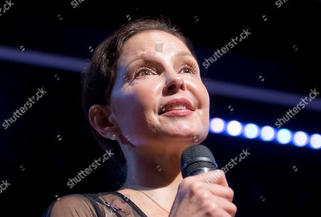 American actress Ashley Judd speaks during a conference about the violence of prostitution in Paris, France, . She has become a symbol of the #metoo movement against sexual harassment, abuse and other wrongdoing by powerful men