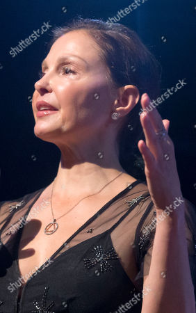 American actress Ashley Judd gestures as she speaks during a conference about the violence of prostitution in Paris, France, . She has become a symbol of the #metoo movement against sexual harassment, abuse and other wrongdoing by powerful men