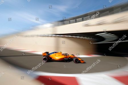 In this image taken with a slow shutter speed, Mclaren driver Stoffel Vandoorne of Belgium steers his car during the third free practice at the Yas Marina racetrack in Abu Dhabi, United Arab Emirates, . The Emirates Formula One Grand Prix will take place on Sunday