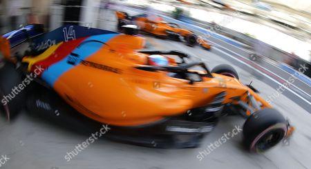 Spanish Formula One driver Fernando Alonso(Front) of McLaren and Belgian Formula One driver Stoffel Vandoorne (Back) of McLaren  during the third practice session of Abu Dhabi Formula 1 Grand Prix 2018 at Yas Marina Circuit in Abu Dhabi, United Arab Emirates on 24 November 2018. The Formula One Grand Prix of Abu Dhabi will take place on 25 November 2018