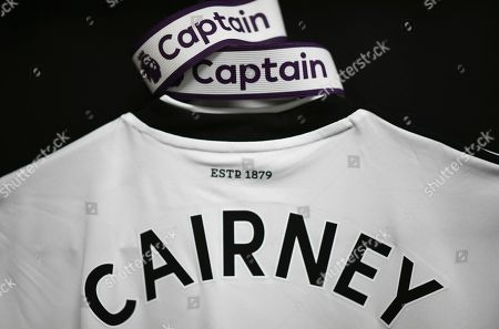 The shirt of Tom Cairney of Fulham hangs in the dressing room