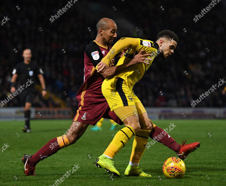 Stock Image of Marcus Browne of Oxford United fends off Karl Henry of Bradford City