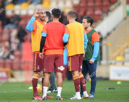New signing Karl Henry of Bradford City (left) gets to know his new team mates during warm up