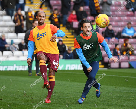 New signing Karl Henry of Bradford City (left) warms up before kick off to make his debut
