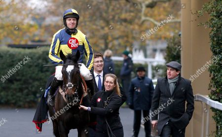 Stock Image of IF THE CAP FITS (Noel Fehily) with Harry Fry and Jason Maguire after The Coral Hurdle Ascot