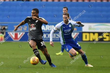 Reading Midfielder, Andy Rinomhota (35) and Wigan Athletic Midfielder, Nick Powell (25) during the EFL Sky Bet Championship match between Wigan Athletic and Reading at the DW Stadium, Wigan