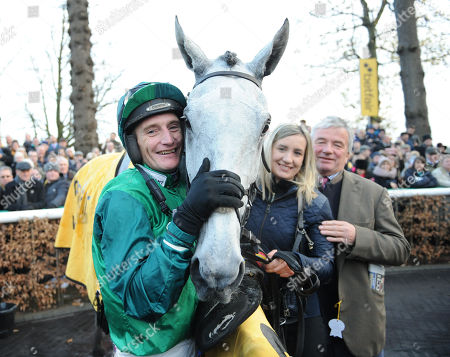 Haydock Park Racecourse The Betfair Steeple Chase. Daryl Jacob in the winners enclosure after riding Bristol De Man to victory with trainer Nigel Twiston-Davies.