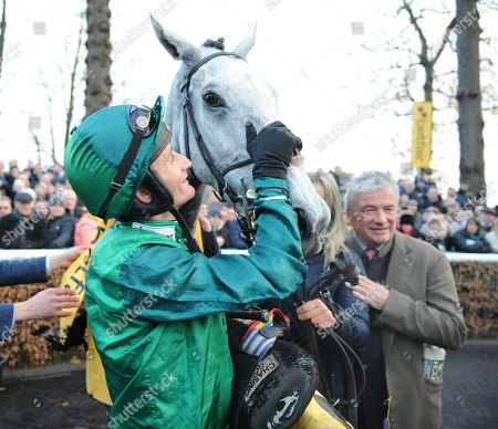 Stock Photo of Haydock Park Racecourse The Betfair Steeple Chase. Daryl Jacob in the winners enclosure after riding Bristol De Man to victory with trainer Nigel Twiston-Davies.