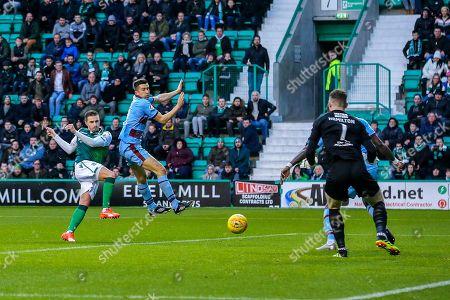 Jamie Maclaren (#9) of Hibernian fires a shot towards goal during the Ladbrokes Scottish Premiership match between Hibernian and Dundee at Easter Road, Edinburgh