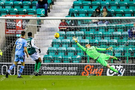 Adam Bogdan (#31) of Hibernian stretches but cannot keep out the shot from Paul McGowan (#18) of Dundee who scores Dundee's second goal (2-2) during the Ladbrokes Scottish Premiership match between Hibernian and Dundee at Easter Road, Edinburgh