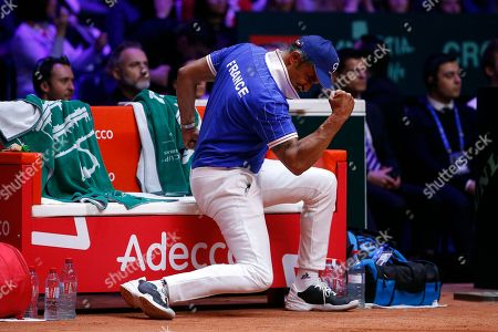 France's team captain Yannick Noah clenches his fist during the Davis Cup final between France and Croatia, in Lille, northern France. Croatia is within one point of a second Davis Cup title after Borna Coric and Marin Cilic dispatched their French rivals in the opening singles matches of the final to take a 2-0 lead