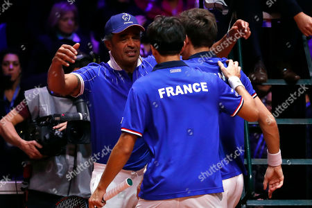 France's Nicolas Mahut, right, and Pierre Hughes Herbert, center, celebrate with their coach Yannick Noah, left, after defeating Croatia's Ivan Dodig and Mate Pavic of Croatia during the Davis Cup final between France and Croatia, in Lille, northern France. Nicolas Mahut and Pierre-Hugues Herbert kept French hopes alive in the Davis Cup final with a 6-4, 6-4, 3-6, 7-6 (3) win over Croatia's Ivan Dodig and Mate Pavic in the doubles on Saturday