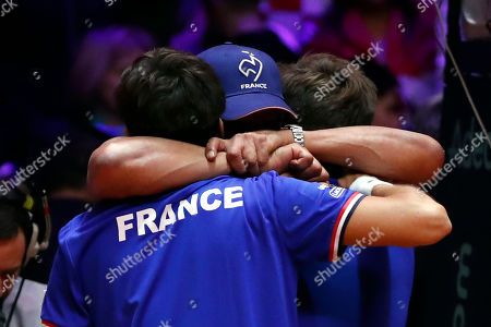 France's Nicolas Mahut, right, and Pierre Hughes Herbert, left, celebrate with their coach Yannick Noah, left, after defeating Croatia's Ivan Dodig and Mate Pavic of Croatia during the Davis Cup final between France and Croatia, in Lille, northern France. Nicolas Mahut and Pierre-Hugues Herbert kept French hopes alive in the Davis Cup final with a 6-4, 6-4, 3-6, 7-6 (3) win over Croatia's Ivan Dodig and Mate Pavic in the doubles on Saturday