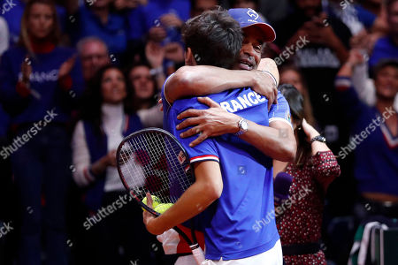 France's Pierre Hughes Herbert, left, celebrates with his coach Yannick Noah after defeating Croatia's Ivan Dodig and Mate Pavic of Croatia during the Davis Cup final between France and Croatia, in Lille, northern France. Nicolas Mahut and Pierre-Hugues Herbert kept French hopes alive in the Davis Cup final with a 6-4, 6-4, 3-6, 7-6 (3) win over Croatia's Ivan Dodig and Mate Pavic in the doubles on Saturday