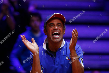 France's team captain Yannick Noah reacts during the Davis Cup final match between France's Nicolas Mahut and Pierre Hughes Herbert and Croatia's Ivan Dodig and Mate Pavic, in Lille, northern France. Nicolas Mahut and Pierre-Hugues Herbert kept French hopes alive in the Davis Cup final with a 6-4, 6-4, 3-6, 7-6 (3) win over Croatia's Ivan Dodig and Mate Pavic in the doubles on Saturday