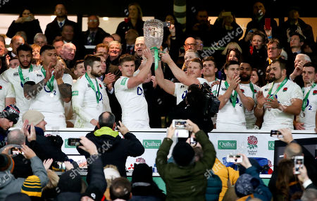 Owen Farrell (Captain) of England & Dylan Hartley of England lift the Cook Cup after victory