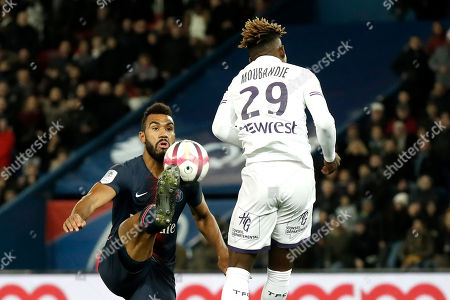 Paris Saint Germain's Eric-Maxim Choupo-Moting (L) in action against Toulouse's Francois Moubandje (R) during the French Ligue 1 soccer match between Paris Saint-Germain (PSG) and Toulouse (TFC)  in Paris, France, 24 November 2018.