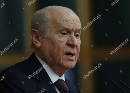 Devlet Bahceli, the leader of Turkey's main nationalist party, Nationalist Movement Party (MHP), addresses his MPs at the parliament in Ankara, Turkey. Bahceli has announced MHP will support President Recep Tayyip Erdogan's party in three major cities in the upcoming local elections. Bahceli said Saturday, Nov. 24, 2018, his party would not field candidates in Istanbul, capital Ankara and western Izmir province for the March 31 municipal elections but support the ruling Justice and Development Party