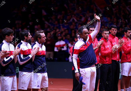 Yannick Noah, team captain of France, waves to the crowd